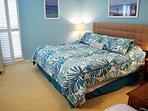 Roomy master bedroom with comfortable furnishings!