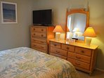Roomy guest bedroom with comfortable furnishings