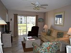 Great space and colors in this living room. Flat screen television for your shows or sports.
