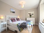 The Master Bedroom is a bright room with a double bed, chest of drawers and large wardrobe.