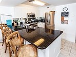 Immaculate granite top bar featuring plenty of additional seatin