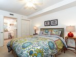 Bright and airy touches tie together this cheerful guest bedroom
