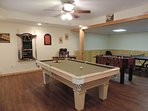Game room with pool table, Foosball table and ping-pong table