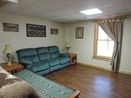 Basement Den with futon and recliner couch