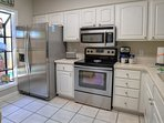 The kitchen contains upscale appliances and plenty of storage.