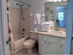 Guest bathroom tub and shower combo.