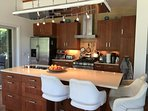 Fully equipped kitchen has stainless steel appliances; Quarts countertop iceland; 4 bar stools, !