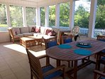 Spacious sunroom has big teak sitting set and dining table w/8 chairs - 12 can sit around