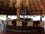 Bar next to pool. Drinks and eats.