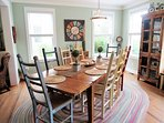 Large cheerful dining table with lots of room for big family dinners