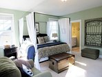 Large master bedroom suite with adjoining master bath featuring a large soaking tub, shower and walk-in closet