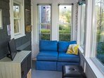 Sunroom has comfortable seating and flat screen tv