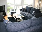 Lounge room upstairs-  has great view of the sea, fire place, TV , DVD player with DVDs