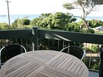 Balcony upstairs- has beautiful views as well as  outdoor table setting for 6 and a BBQ .