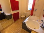 Bathroom, with vanity, shower and large japanese bath
