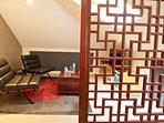 Blackwattle room sitting/TV room viewed through the handcrafted Chinesse screen.