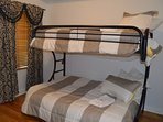 Downstairs - Guest Room 5 - Twin/Full Bunk Beds. Sleeps 3