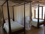2nd spacious ensuite bedroom with AC and mosquito nets.