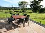 Patio dining area with terrific views across Cameron Muir