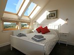 Smallest of the upstairs en-suite bedrooms (and our favourite)  Great views from the bed!