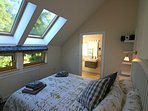 From this en-suite bedroom you can see Ben Lomond (the mountain) through the trees.
