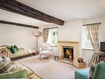 Spacious yet cosy living room, with log burner