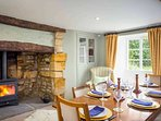 Beautiful dining room, with a log burner in a large inglenook fireplace
