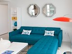 Sofa with chaise longe to relax, read, watch the Bay
