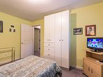 Lower level guest, trundle bed opens up to two singles