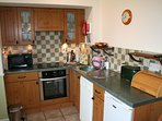 The kitchen includes dishwasher, fridge, microwave, electric cooker and there is also a utility room