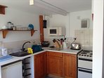 Kitchen area. Includes oven, microwave and fridge.