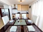 Big kitchen is fully equipped and had great dining area