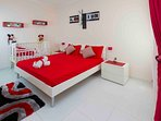 Spare Bedroom with King Bed and Baby Bed