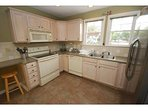 Kitchen - Fully stocked with cooking needs - Pots, Pans, dishes, cups, coffee maker etc