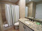 Hall Bath With Adjacent Door to Bunk Bedroom