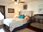 Master Bedroom w/Bath, crib/changing table, double closets, Tv, luggage rack, downstairs.