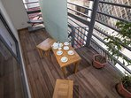 lovely balcony with a small table set