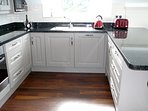 Kitchen Space with Oven, hob, microwave, integrated fridge and dishwasher