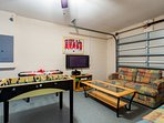 Games room with table football, air hockey, flat screen TV with Xbox360, games and selection of DVDs