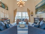 Open the front door to the Living Room with spectacular 22 foot soaring ceiling