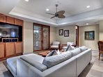 Game Room with Large Flat Screen opens to patios
