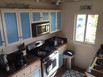 Refurbished Galley Kitchen with every modern Appliance, lots of crockery etc. Laundry room adjacent.