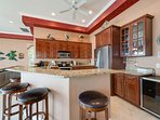 Expansive fully equipped Kitchen with island bar and wine refrigerator