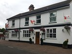 The White Horse Inn opposite, good food & family friendly.