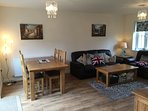 View of the living room and dining area from the kitchen.  Perfect for families