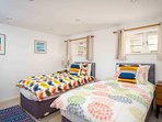 Bedroom 3, colourful and fun, which can be set up as either two singles or a super king size bed