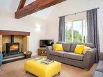The ground floor living room with roaring log burner