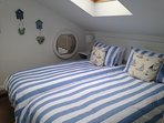 Upstairs bedroom with twin single beds