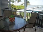 Relax with a drink or meal on the screened-in lanai overlooking the bay and pool.