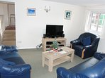 Comfortable Lounge -flat screen television,  blu ray DVD player, DVDs, board games & childrens' toys